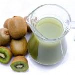 Jug of kiwi juice and some fresh kiwis — Stock Photo #53762625