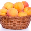Fresh tasty apricots in a basket — Stock Photo #53929379