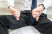 Discouraged businessman sitting on the floor — Stock Photo
