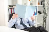 Relaxed businessman analyzing a document — Photo