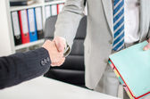 Business associates shaking hands — Stock Photo