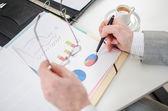 Businessman checking financial graphs — Photo