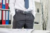 Business man standing with his hands in pockets — ストック写真