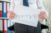 Businessman showing graphs with poor results — Photo