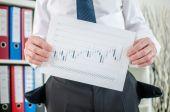 Businessman showing graphs with poor results — ストック写真