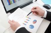 Businessman checking financial charts — ストック写真