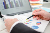 Businessman checking financial charts — Photo