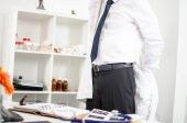 Doctor arriving in office — Stock Photo