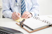 Doctor taking notes — Stock Photo