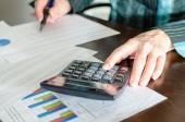 Female accountant checking financial documents — Stock Photo