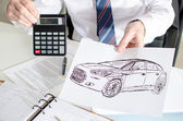 Car salesman showing the price of a car — Stock Photo