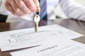 Estate agent holding house keys — Stock Photo