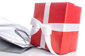 Gift with paper shopping bag — Stock Photo