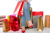 Woman sitting in the middle of shopping bags — Stock Photo