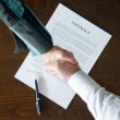 Handshake over signed contract — Stock Photo #63614099