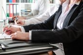Business people taking notes — Stock Photo