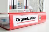 Organization wording on a binder — Stock Photo