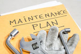 Tools on a folder of maintenance plan — Stock Photo