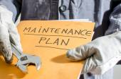 Worker holding a folder of maintenance plan and monkey wrench — Foto Stock