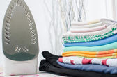 Iron and ironed linen on a ironing board — Stock Photo