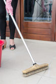 Cleaning of tiled floor — Stockfoto