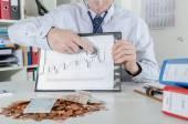 Businessman analyzing financial market — Stock Photo
