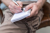 Man taking notes on a pocket book — Stock Photo