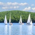 Yachts on Lake Turgoyak, Southern Urals — Stock Photo #65307635