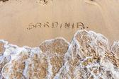 Sardinia word drawn on the beach — Stockfoto