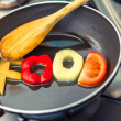 Food word written with letters formed from vegetables — Stock Photo #55400345