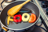Food word written with letters formed from vegetables — Stock Photo