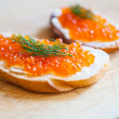Sandwiches with salmon red caviar and fennel — Stock Photo #55428809