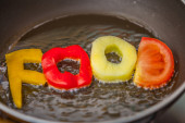 Food Letters on frying pan — Stock Photo