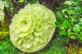 Cantaloupe  fruit carving in the garden. on table sets. — Stock Photo