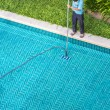 Постер, плакат: Worker cleaning the pool