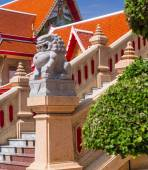 Granite lion Statue stay in front of at thai temple — Stock Photo