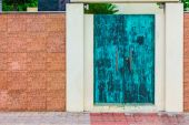 Antique copper door and contemporary wall. — Stock Photo