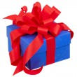 Blue gift box with red ribbon and bow isolated on white — Stock Photo #52009873
