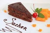 Fresh chocolate sacher cake with decoration — Stock Photo