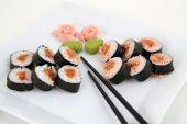 Sushi set on white plate. Traditional japanese sushi rolls — Stock Photo