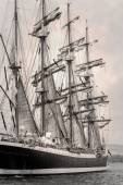 Old ship with white sales in black and white — Stock Photo