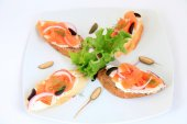 Sandwiches with salmon with decoration. Tapas food — Stock Photo