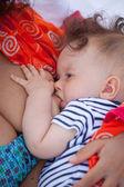 Breastfeeding baby — Stock Photo