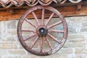 Old wagon wheel on the wall — Stock Photo