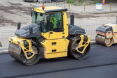 Large road-roller paving a road. Road construction — Stock Photo