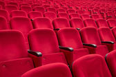 Empty red cinema or theatre seats — Zdjęcie stockowe