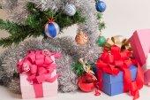 Christmas gift boxes and Christmas Tree — Stock Photo