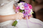 Wedding bouquet in the hands of  bride — Stock Photo