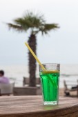 Coctail on wooden table. Beach — Stock Photo