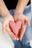 Woman hands holding a heart — Stock Photo